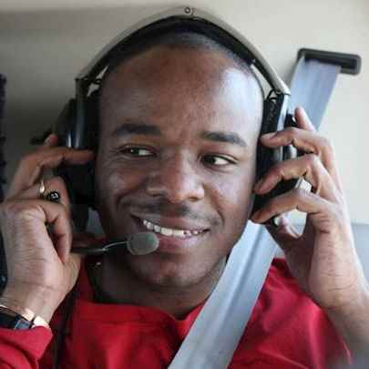 image_library/full/Stephen_in_the_heli_April_2011.jpg - Stephen Wiltshire media archive